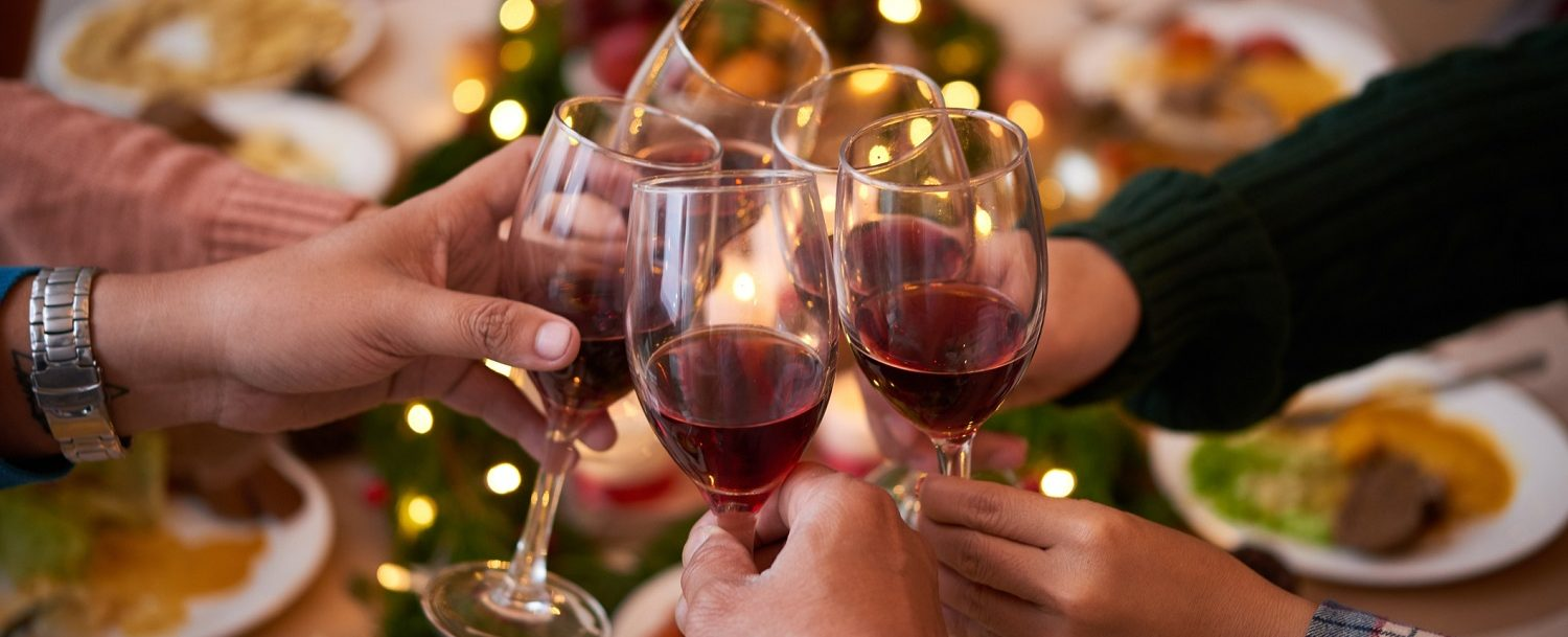 Group of people toasting at a holiday party